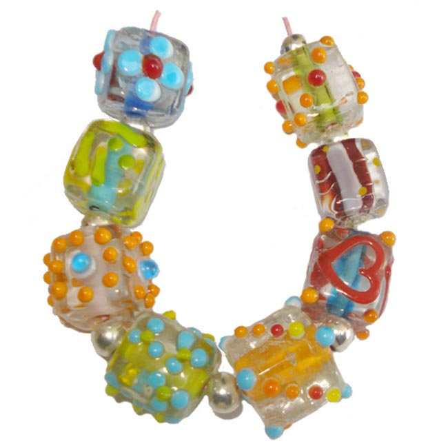 Lampwork fancy glass beads 8 pieces strung in a thread,